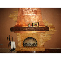 Case studies. Kharkov. Exquisite fireplace with wrought copper facing.